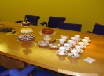 Boardroom table, set up for tea and cake