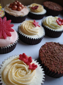 Rose swirl and dainty flowers cupcake