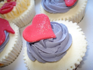 Red heart on lilac swirl cupcake