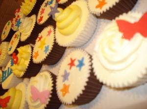 Rainbow coloured cupcakes