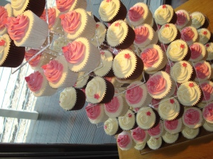 Pink and ivory cupcakes with flower and heart decorations