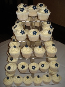 Ivory and navy wedding cupcakes on 5 tiered stand