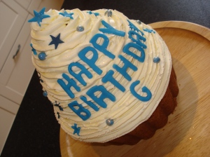 Giant boys birthday cupcake