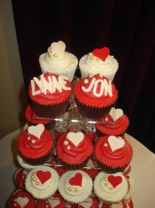 The top tier of wedding cupcakes