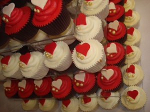 7 tiers of red and ivory cupcakes