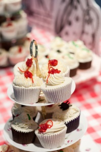 Red string decorated cupcakes