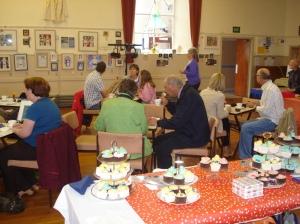 Festival goers enjoying tea and cake!