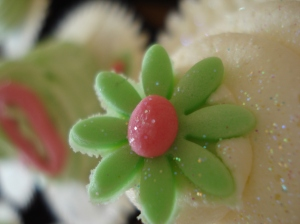 Green flower on white swirl with chocolate sponge