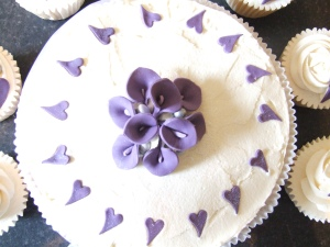 Purple Cala Lily wedding cake and cupcakes