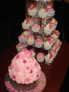 Giant cupcake and tower of rose themed girly cupcakes